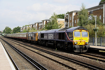 4 September. 66730 leads 73204 Janice into Kensington Olympia with the 1Z08 0751 Ipswich - Portsmouth Harbour GBRf staff special. The Portsmouth Belle.