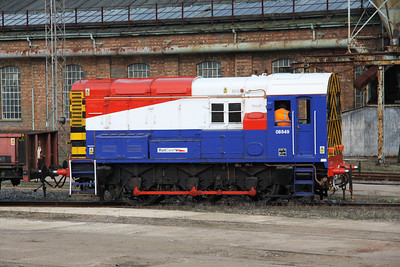 2 April. 08649 is seen in full RailCare livery inside Wolverton Works forming a class 465 move.