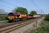 25 April. 66007 looking very clean heads past Chelmscote with a Wembley - Wolverton Works move conveying 465180.