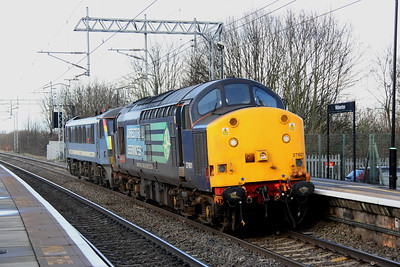 16 December. 37601 Class  37- 'Fifty' leads 90006 Modern Railways Magazine/Roger Ford through Wolverton working the 0Z30 1020 Crewe EMD - Norwich Crown Point. This consist will pick up DVT 82121 from Wolverton centre sidings for onward movement to Norwich.