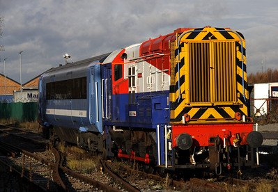 16 December. Works pilot, 08649 Wolverton is seen heading along parallel to McConnell Drive with DVT 82121. The DVT is en route to the centre sidings on the main line for collection and forwarding to Norwich Crown Point by 37601.
