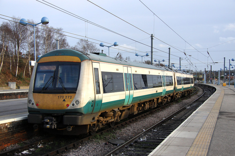 28 December. One of only three class 170's to retain Anglia Railways Turbostar livery is 170272. She is seen here departing Norwich with the 1440 to Cambridge.