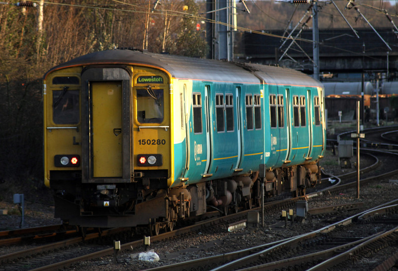 28 December. On hire to NXEA, Arriva Trains Wales liveried 150280 leaves Norwich at 1506 heading for that well known Welsh coastal town of ..... Lowestoft.
