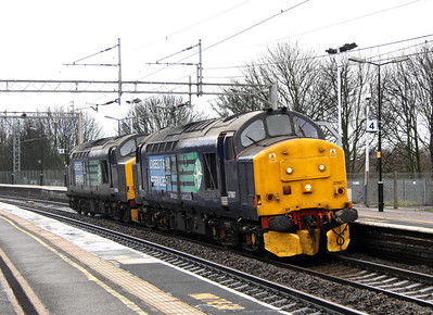 26 February. Growling tractors 37667 + 37510 pass Wolverton working the 0Z37 Crewe - Sheerness.