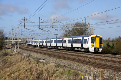 12 February. Brand new Stansted Express units 379001 + 379005 zip south at Chelmscote working the 5S10 Crewe - Wembley.