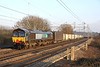 21 January. 66425 catches the sun nicely passing Chelmscote with the 4M71 1053 Tilbury - Daventry.