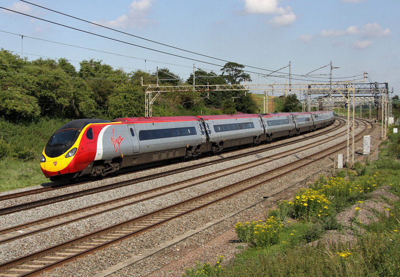 2 July. 390047 CLIC Sargent heads north sweeping towards Chelmscote and Soulbury.