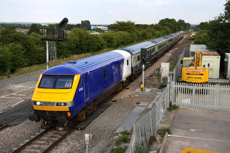 1 July. The uniquely liveried DVT 82302 leads the 1806 Marylebone - Banbury into Bicester North .