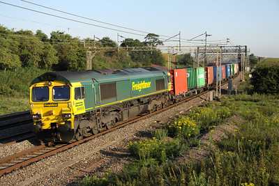 2 July. The 4O86 0503 Lawley Street - Thamesport(Grain) passing Old Linslade behind 66505.