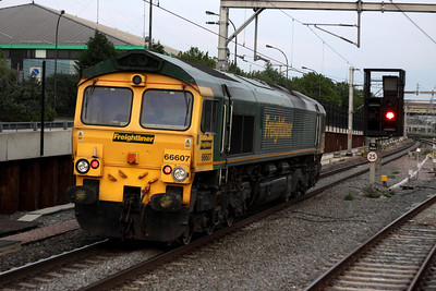 4 July. Freightliner Heavy Haul 66607 is seen passing south, light engine through Milton Keynes.