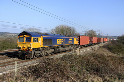 4 March. Unusually running on the fast, 66707 Sir Sam Fay GREAT CENTRAL RAILWAY passes Chelmscote with 4M23 1059 Felixstowe - Hams Hall.