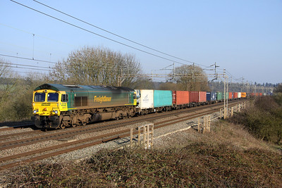 4 March. 66575 catches the sun as she passes Chelmscote working the 4M58 0950 Southampton - Crewe Basford Hall. The train was running over an hour late as she passed.