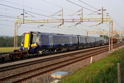 6 June. The last of the 3 car units for delivery to Scotrail, 380022 is seen passing Soulbury in the consist of 7X80 1315 Dollands Moor - Polmadie TRSMD.