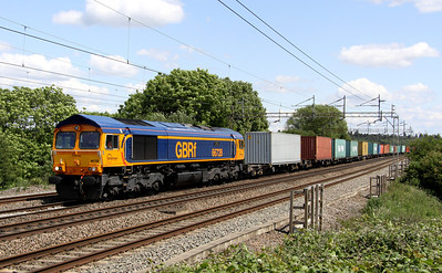 11 June. Recently repainted in corporate GBRf Europorte livery, 66728 Institution of Railway Operators passes Chelmscote with the 4M23 1019 Felixstowe - Hams Hall.