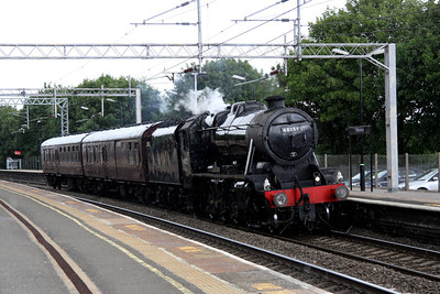 18 June. Steam 48151 GAUGE 'O' GUILD is seen passing Wolverton in the rain whilst working the 5Z55 0545 Carnforth - Southall.