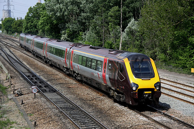 4 May. 221128 crosses onto the fast at Moreton Cutting with the 0927 Manchester Piccadilly - Bournemouth.