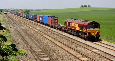 4 May. With a good load, 66116 hauls the 4O23 1113 Hams Hall - Southampton past Cholsey Manor Farm.