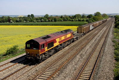 4 May. 66148 passes Cholsey Manor Farm with the 6V38 1101 Marchwood - Didcot Yard MOD service.