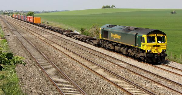 4 May. 66955 hauls a half empty half full liner, the 4L32 1100 Bristol FLT - Tilbury past Cholsey Manor Farm.