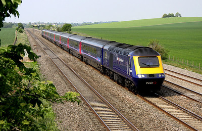 4 May. With 43141 on the rear, 43140 leads a London bound service past Cholsey Manor Farm.
