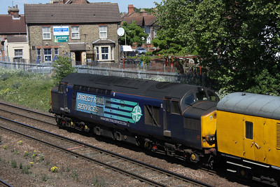 2 May. 37069 is seen on the rear of 1Z02 1010 Derby RTC - Ferme Park at Bedford North Junction.