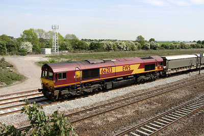 4 May. Having just pulled away from a red signal, 66213 heads the 6M48 1011 Southampton Eastern Docks - Warrington Arpley.