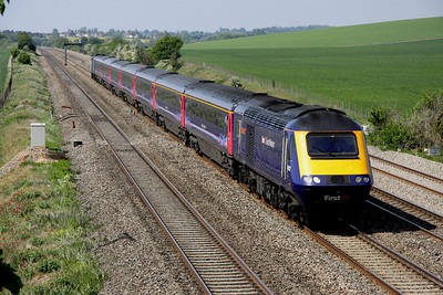 4 May. Another Paddington bound service at Cholsey Manor Farm with 43132 We Save The Children - Will You ? leading the way.