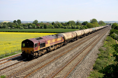 4 May. With Cholsey station in the distance, 66151 leads past Manor Farm with the 6E55 1335 Theale - Lindsey.