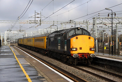 12 November. Original DRS liveried 37607 storms through Bletchley on the fast working the 1Q18 Nuneaton - Euston. Compass liveried 37611 was on the rear.