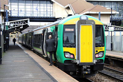 5 November. Checking all are aboard, 172333 calls at The Hawthorns working the 1139 Whitlocks End - Kidderminster.