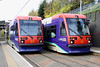 5 November. Carrying the old Midland Metro livery, 03 RAY LEWIS heads for Wolverhampton St. Georges and 012 heads for Birmingham Snow Hill at The Hawthorns.
