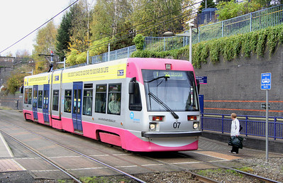 5 November. Displaying the new silver and pink livery now being applied to the Midland Metro fleet, 07 BILLY WRIGHT pulls away from The Hawthorns heading for Snow Hill.