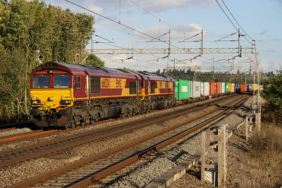 7 October. Sequentially numbered 66024 + 66025 double head the 4M00 0903 Ipswich Griffin Wharf - Hams Hall past Chelmscote.