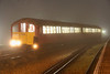 16 October. An illuminated 483007 stands at a very foggy Ryde depot.