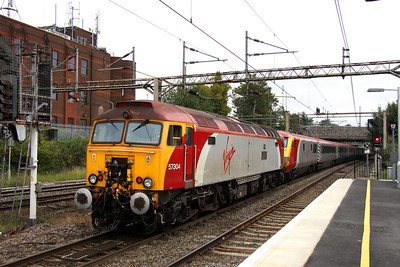 3 September. Unfortunately with 50049 Defiance unavailable, 57304 GORDON TRACY was used as the second loco to help in run round working in North Wales. Seen here on the rear departing Watford.