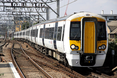 3 September. The 1240 Liverpool Street - Stansted Airport passes Bethnal Green behind 379014 + 379017