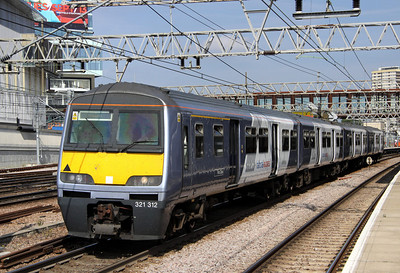 3 September. In full NX livery, 321312 Southend-on-Sea departs Stratford in charge of the 1300 Braintree - Liverpool Street.