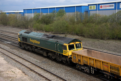 3 April. Heading away from camera, 66619 Derek W. Johnson MBE passes north at Banbury stone terminal working the 6M40 1156 Westbury Virtual Quarry - Stud Farm empty ballast boxes.
