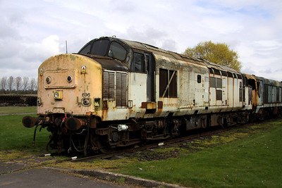3 April. With what remains of her Transrail livery, 37696 sits silently at Long Marston. The former 37228 was taken from traffic in July 2000.