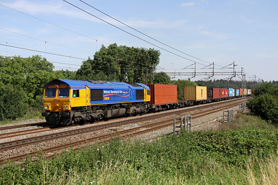 10 August. Defunct Metronet liveried 66721 Harry Beck coasts past Chelmscote atop the 4M23 1045 Felixstowe - Hams Hall.
