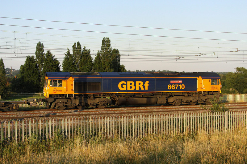 10 August. Running 150 minutes + late due to lineside equipment failure, 66710 Phil Packer BRIT catches the last of the days sun at Stoke Hammond with the 4L22 1521 Hams Hall - Felixstowe.