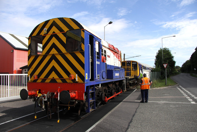 17 August. Long time resident on Wolverton Works, 313121 left for Wembley and is seen being pushed along McConnell Drive by resident shunter 08649 Wolverton.