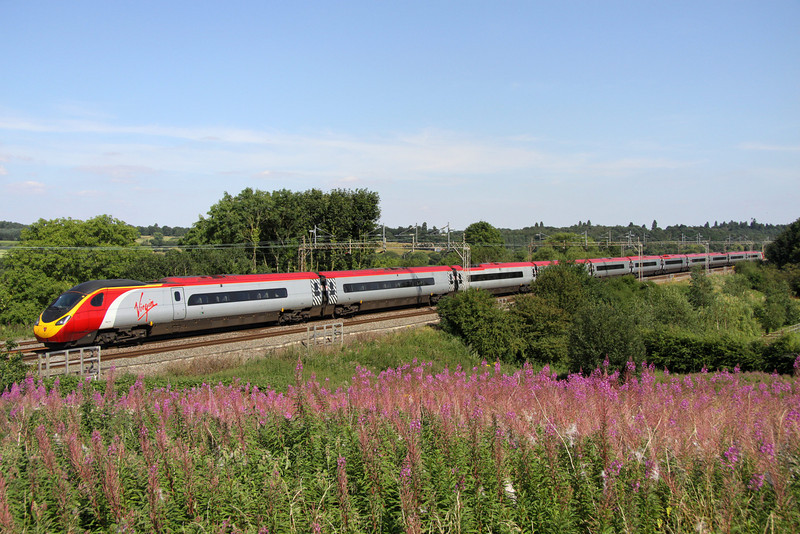 10 August. A tight fit but an eleven car Pendolino just fits into view as 390112 Virgin Star heads for London at Chelmscote.