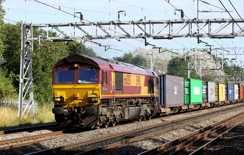 17 August. One of only a few DBS 66's to be named, 66050 EWS Energy takes 4M00 0902 Ipswich Griffin Wharf - Hams Hall past Bradwell.