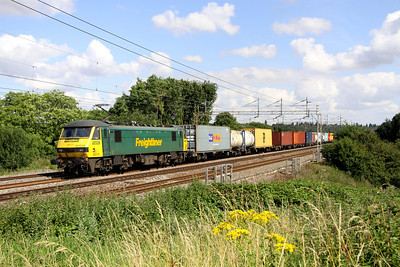 14 August. Freightliner's 90016 works the 4M81 0730 Felixstowe - Crewe past Chelmscote.