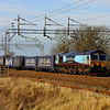 2 December. Malcolm 66434 heads south at Chelmscote on the Tesco, the 4L48 1203 Daventry - Tilbury.