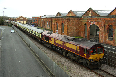 21 January. The Concrete Cow heads forward with 66213 on the rear towards Haversham Bank. The building at the rear with the cream doors was the former Royal Train shed, now converted to housing.