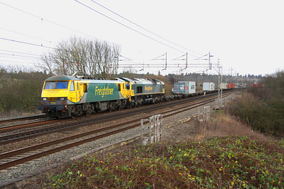 7 January. Within two hours the full sun is just a memory as 90049 pilots 66566 past Chelmscote on the late running 4M87 0920 Felixstowe - Crewe.