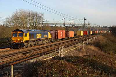 13 January. GBRf 66708 Jayne catches the winter sun at Chelmscote working the 4M23 1045 Felixstowe - Hams Hall.