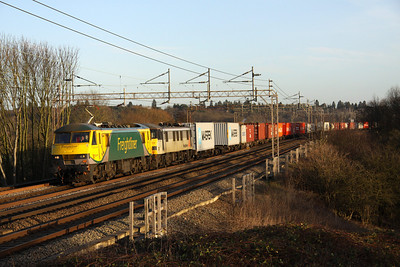 13 January. PowerHaul 90049 leads failed sister 90048 at Chelmscote on the 4M88 0920 Felixstowe - Crewe liner.
